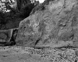 The cliff face at Rāpaki beach has been carved into by locals and visitors for generations. This part of the beach, directly in front of the church and burial ground, is considered tapu. When a member of the community passed away their clothing and bedding would be burnt here at low tide.