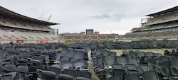 Preparatory stages of demolition. Looking South from old ticket gate across stadium chairs sold on Trade Me.